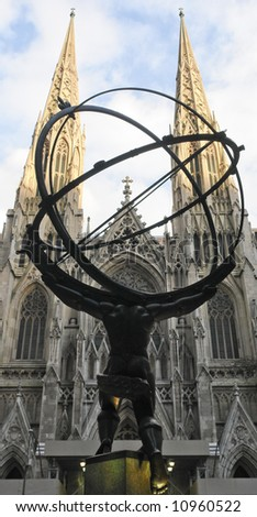 Saint Patrick cathedral in New York viewed from behind the statue of Atlas from the Rockefeller Center by Lee Lawrie and Rene Chambellan (1936) - stock photo
