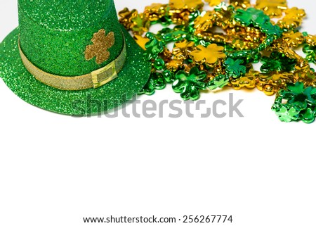 Saint Patrick's day decorations with a hat and beads on a white background - stock photo