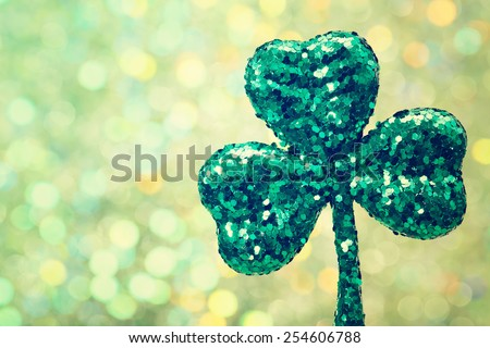 Saint Patrick's Day shiny green clover ornament - stock photo