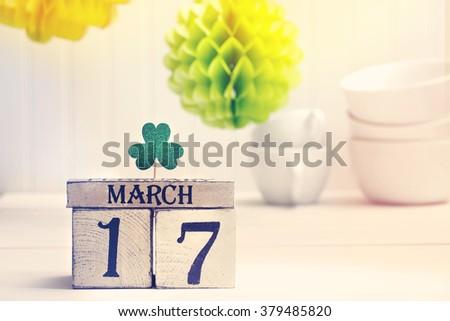 Saint Patricks Day green clover with wooden block calendar - stock photo