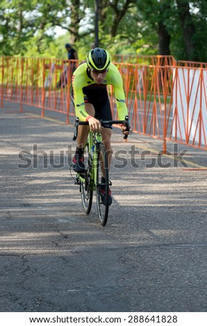 SAINT PAUL, MN/USA -  JUNE 17, 2015: Pro cyclist Efren Ortega races in Stage One time trial at the prestigious North Star Grand Prix pro cycling event in Saint Paul. - stock photo