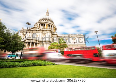 Saint Paul's cathedral in London, UK. It's an Anglican cathedral, the seat of the Bishop of London and the mother church of the Diocese of London. Long exposure capture during every day traffic. - stock photo