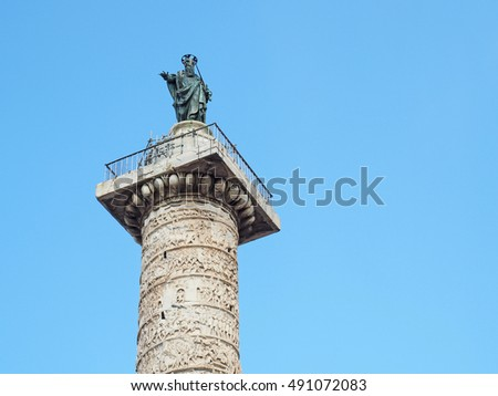 Saint Paul statue on the top of Marcus Aurelius Column at Piazza Colonna in Rome, Italy