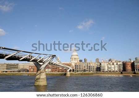 Saint Pauls Cathedral and Millennium Bridge over River Thames, London - stock photo