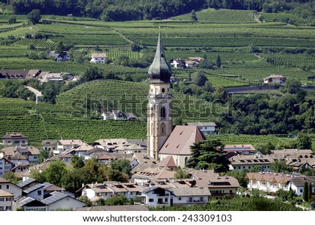 Saint Pauls, South Tyrol, Italy - September 7, 2014: Gothic parish church of St. Pauls in the vineyards along the South Tyrolean wine street near Bolzano.