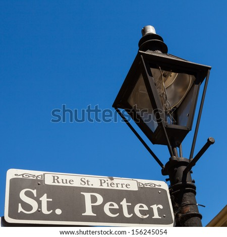 Saint Peter street sign in the French Quarter in New Orleans, Louisiana. - stock photo