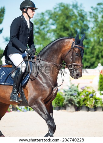 SAINT PETERSBURG-JULY 06: Rider Kristapas Neretnieks on Karamsin in the CSI3*-W/CSIYH1* International Jumping Grand Prix FEI World Cup Competition 160cm on July 06, 2014 in Saint Petersburg, Russia.