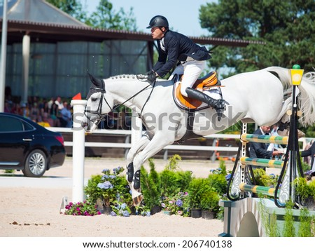 SAINT PETERSBURG-JULY 06: Rider Mikhail Safronov on Copperphild in the CSI3*-W/CSIYH1* International Jumping Grand Prix FEI World Cup Competition 160cm on July 06, 2014 in Saint Petersburg, Russia.