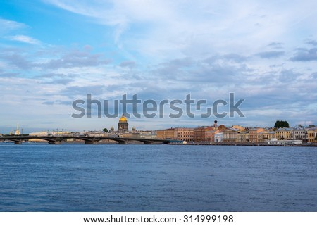 Saint Petersburg riverside with views of Blagoveshchensky bridge and the dome of Saint Isaac's Cathedral