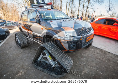 Saint-Petersburg, Russia - April 11, 2015: All-terrain cross-country vehicle on tracks based on European modification of Ford Fusion car - stock photo