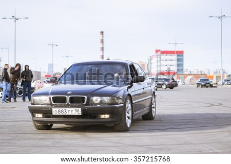 SAINT-PETERSBURG, RUSSIA - APRIL 5, 2014: Old-car BMW 7-series at the meeting fans of the Bavarian automaker, St. Petersburg, Russia - stock photo