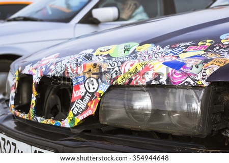 SAINT-PETERSBURG, RUSSIA - APRIL 5, 2014: Old-car BMW 3-series with color stickers at the meeting fans of the Bavarian automaker, St. Petersburg, Russia - stock photo