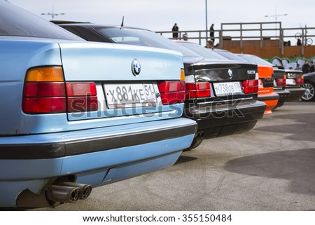 SAINT-PETERSBURG, RUSSIA - APRIL 5, 2014: Old-cars BMW 5-series e34 at the meeting fans of the Bavarian automaker, St. Petersburg, Russia - stock photo