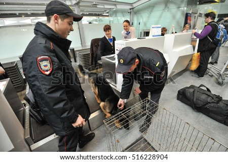 Saint-Petersburg, Russia - April 28, 2016: Police at the airport Pulkovo are registered service dogs for the flight by plane.