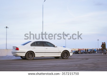 SAINT-PETERSBURG, RUSSIA - APRIL 5, 2014: White old-car BMW to drift at the meeting fans of the Bavarian automaker, St. Petersburg, Russia - stock photo