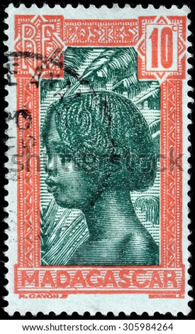 SAINT-PETERSBURG, RUSSIA - AUGUST 10, 2015: A stamp printed by MADAGASCAR shows image portrait of Hova Girl from Madagascar, circa December, 1930. - stock photo