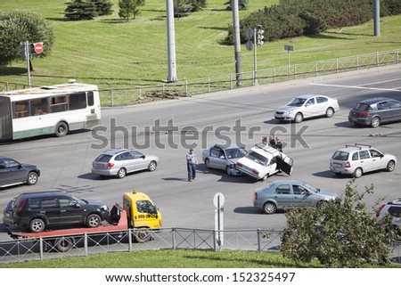 SAINT-PETERSBURG, RUSSIA-AUGUST 16, 2013: Car accident in street intersection on August 16, 2013 in Saint-Petersburg, Russia. Crash between two cars on drive at red traffic light. No one was injured