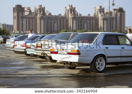 SAINT-PETERSBURG, RUSSIA - AUGUST 3, 2013: Old-car BMW 3-series e30 at the meeting, fans of the Bavarian automaker, Krestovsky island, St. Petersburg - stock photo