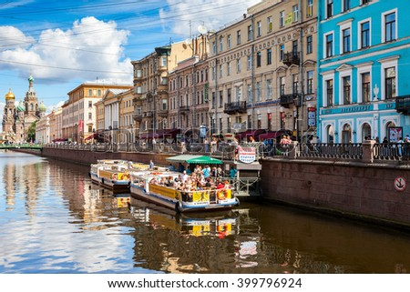 SAINT-PETERSBURG, RUSSIA - AUGUST 5, 2015: River cruise passenger boats moored on Griboedov channel in the historic city in sunny day - stock photo