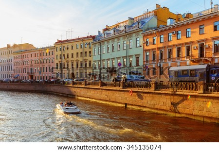 Saint Petersburg/Russia - August 11, 2015: The embankment of Griboyedov Canal at sunset time - stock photo