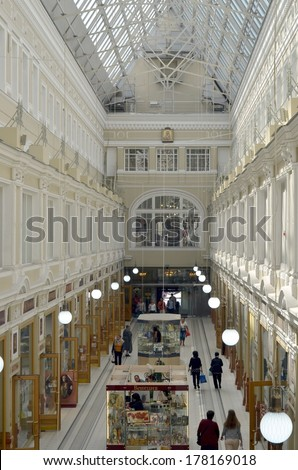 SAINT-PETERSBURG, RUSSIA, AUGUST 24, 2013: The Passage shopping mall interior in Saint-Petersburg. The Passage  celebrated its 150th anniversary in 1998