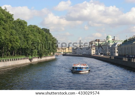 SAINT PETERSBURG, RUSSIA, - AUGUST 16, 2015: Two cruise boats on Fontanka river.
