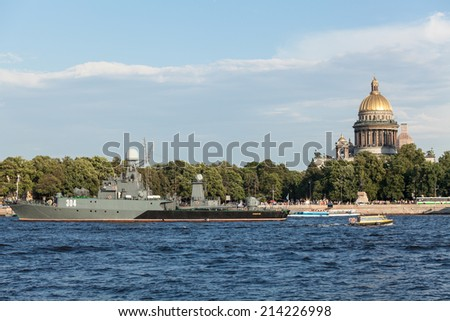 SAINT-PETERSBURG, RUSSIA - CIRCA AUGUST, 2014: Military ship is moored near Isaac Cathedral for celebration day of Russian Navy, Saint-Petersburg, Russia. Day of the Russian Navy