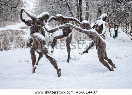 "Saint Petersburg, Russia, February 7, 2015. The sculpture ""Dance"" based on the Henri Matisse painting  in the park at the Yelagin Island in the snow fall."