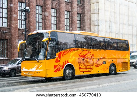 SAINT PETERSBURG, RUSSIA - FEBRUARY 9, 2011: Touristic coach Jonckheere Arrow in the city street during a snowfall. - stock photo