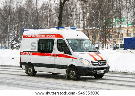 SAINT PETERSBURG, RUSSIA - FEBRUARY 9, 2011: White ambulance car Mercedes-Benz Sprinter in the city street.