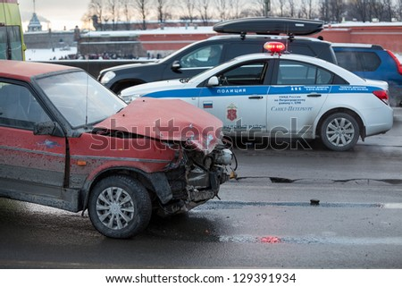 SAINT-PETERSBURG, RUSSIA-JANUARY 19: Crashed car after frontal impact is on city street with police on January 19, 2013 in Saint-Petersburg, Russia. Driving oncoming traffic lane. No one was injured.