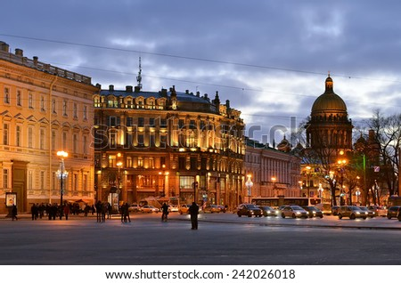 SAINT PETERSBURG, RUSSIA - JANUARY 5, 2015:  Evening illumination of Saint Petersburg. Unknown people walking to the Palace square.  - stock photo