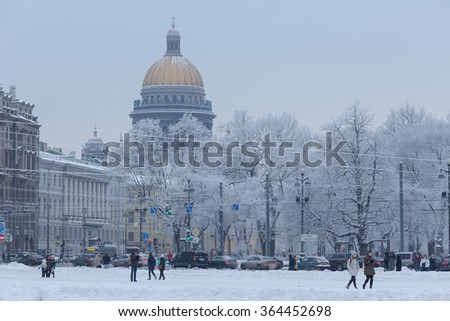 SAINT-PETERSBURG, RUSSIA - JANUARY 17: view of St. Isaac's Cathedral and the Alexander Garden from the Palace Square, January 17, 2016 in Petersburg, Russia. - stock photo