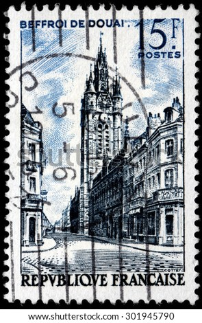SAINT-PETERSBURG, RUSSIA - JULY 14, 2015: A stamp printed by FRANCE shows view of Bell Tower of Douai. Douai is a commune in the Nord department in northern France, circa February, 1956 - stock photo
