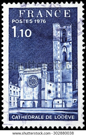SAINT-PETERSBURG, RUSSIA - JULY 14, 2015: A stamp printed by FRANCE shows view of the Lodeve Cathedral. Lodeve is a commune in Languedoc-Roussillon region in France, circa November, 1976 - stock photo