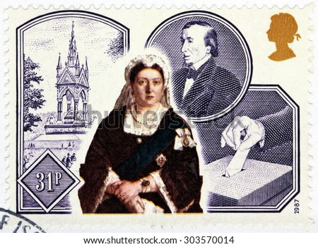 SAINT-PETERSBURG, RUSSIA - JULY 14, 2015: A stamp printed by GREAT BRITAIN shows Queen Victoria against images of Albert Memorial, Ballot Box and Benjamin Disraeli, circa September 1987 - stock photo