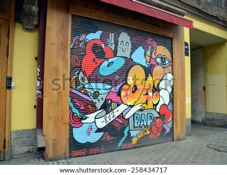 SAINT-PETERSBURG, RUSSIA, MARCH 1, 2015 - Bright graffiti on the shutters of the bar in Saint Petersburg