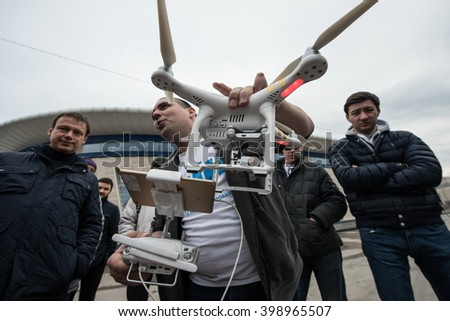 Saint-Petersburg, Russia - March 26, 2016: Experienced user-drone pilot is shared with the people experience the use of drones to take photos and videos from a bird's flight.