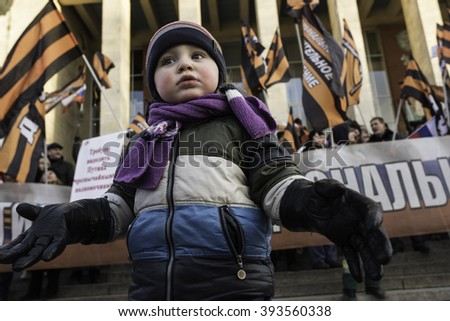Saint-Petersburg, Russia - March 18, 2016: the rally on the occasion of the second anniversary of the reunion of Crimea to Russia, child on the background of the protesters - stock photo