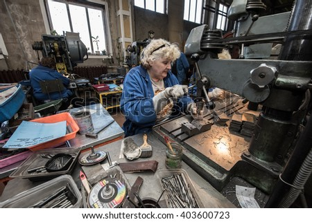 Saint-Petersburg, Russia - March 23, 2016: Women 50-55 years is working on drilling machines in the metalworking shop