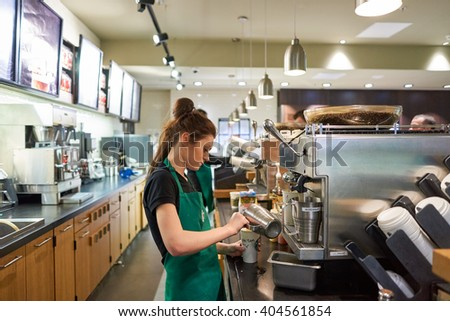 SAINT PETERSBURG, RUSSIA - MARCH 12, 2016: worker at Starbucks Cafe. Starbucks Corporation is an American global coffee company and coffeehouse chain based in Seattle, Washington