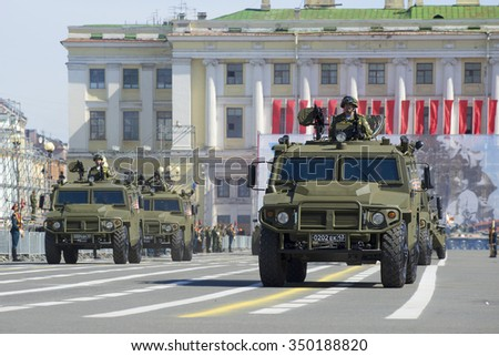 "SAINT-PETERSBURG, RUSSIA - MAY 05, 2015: A convoy of military armoured multipurpose cars ""Tiger"" on rehearsal of parade in honor of Victory Day"