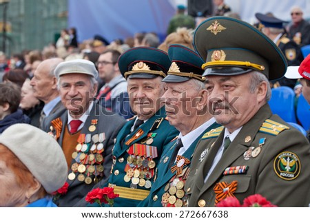 Saint Petersburg /RUSSIA - MAY 9: Old   veterans of  WWII  decorated with  medals during festivities devoted to anniversary of Victory Day on May 9, 2013 in Saint- Petersburg