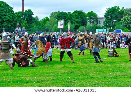 "SAINT PETERSBURG, RUSSIA -MAY 27,2016. Open air festival of Norwegian culture ""Legends of the Norwegian Viking"",Peter and Paul fortress. Reconstruction battle of military history of Viking Age clubs"