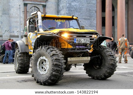 SAINT PETERSBURG, RUSSIA - MAY 25: Sanna Wasstroem's off-road vehicle The Beast No.403 competes at the annual Ladoga Trophy Challenge on May 25, 2013 in Saint Petersburg, Russia. - stock photo