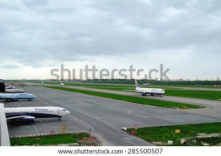 SAINT-PETERSBURG, RUSSIA - MAY 23, 2015. The airplanes of various international airlines (Transaero, Nordstar,Alrosa,Nordavia,S7) parking, riding and landing on the runway of Pulkovo airport