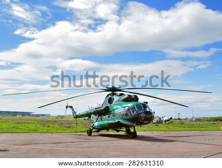 SAINT-PETERSBURG, RUSSIA - MAY 23, 2015. The Mil Mi-8  (registration number RA-24243) helicopter of Spark Avia Airline Company at the parking in Pulkovo airport