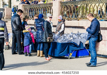 Saint Petersburg, Russia, May 9, 2015. Victory Day celebration. The girl selling sailor shirts at the Lieutenant Schmidt embankment.