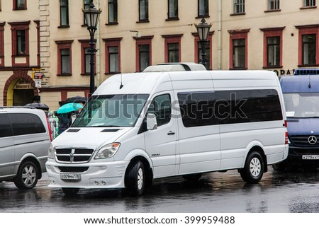 SAINT PETERSBURG, RUSSIA - MAY 25, 2013: White compact bus Dodge Sprinter in the city street. - stock photo