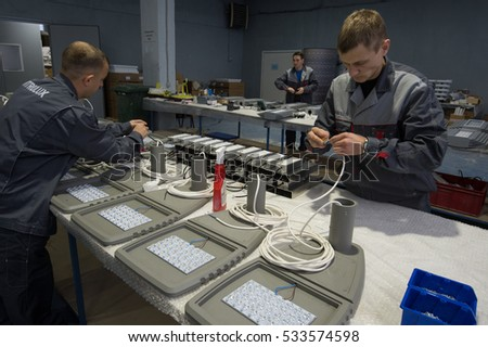 Saint-Petersburg, Russia - November 30, 2016: Electricians  in the shop assembling urban electric lamps. for the production of lighting equipment factory.